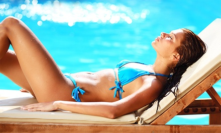 One or Two Custom Spray Tans at Designer Shades (Up to 50% Off)