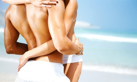 One or Two Fantasy Tan Spray Tans at Zena's Spa and Salon (Up to 55% Off)