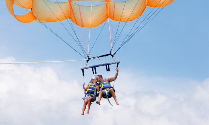 Visit Palm Beach - Singer Island - Sailfish Marina: $99 for a Tandem-Parasailing Experience for Two from Visit Palm Beach (Up to $170 Value)