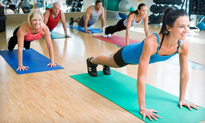In Motion Anytime - Ortonville: One Pole Dance Lesson, Three Paddle-Board Yoga Lessons, or Drop-In Fitness Classes at In Motion Anytime in Ortonville (Up to 89% Off)