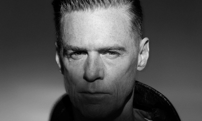 Bryan Adams - DTE Energy Music Theatre: Bryan Adams: The Reckless Tour at DTE Energy Music Theatre on July 23 at 8 p.m. (Up to 56% Off)