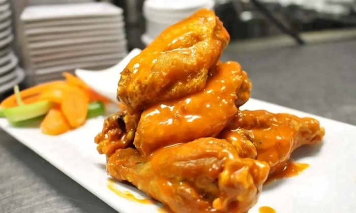 Ideal Wings & Pommes Frites - Huntington: $24 for Three Groupons, Each Good for $15 Worth of Wings and Belgian Fries at Ideal Wings & Pommes Frites ($45 Total Value)