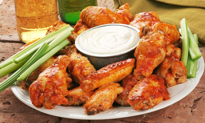 Wings-N-Ale - Coral Springs: $19 for 50 Grilled or Fried Chicken Wings at Wings-N-Ale (Up to $38.95 Value)