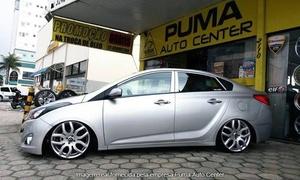Puma Auto Center: Puma Auto Center – Itajaí: alinhamento e balanceamento (com alinhamento de faróis e troca de óleo)