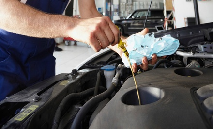 $25 for Oil-Change Package with 72-Point Inspection at Grismer Tire ($60.49 Value)