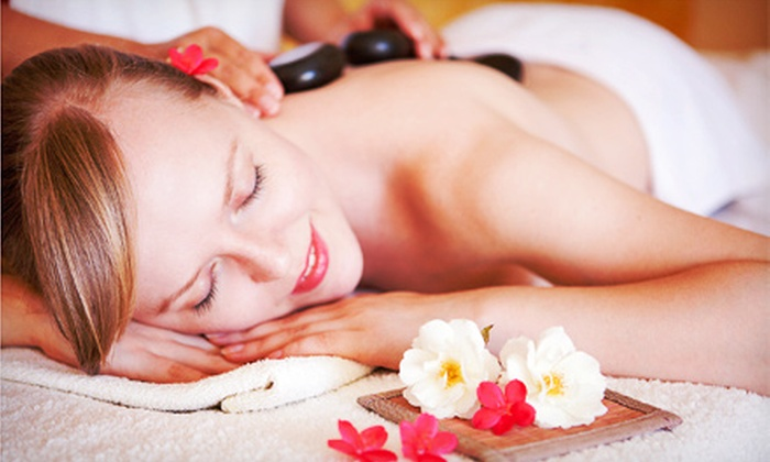Kissed by the Sun Spa - Easton: One or Two 60-Minute Lomi Lomi Massages with Aromatherapy and Hot Stones at Kissed by the Sun Spa (Up to 52% Off)
