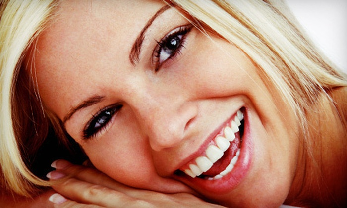 About Smiles Family & Cosmetic Dentistry - Westgate: $39 for a Dental Package with Exam, X-rays, and Cleaning at About Smiles Family & Cosmetic Dentistry ($239 Value)