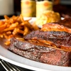 Up to 52% Off Lunch or Dinner for 2 or 4 at Charlie's Pit Bar B Que