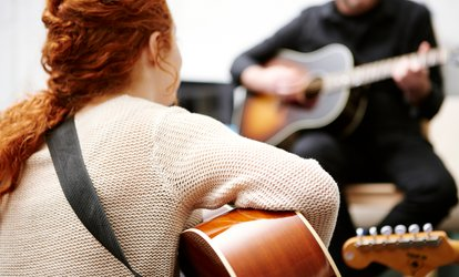image for Two 30-Minute Guitar <strong>Lessons</strong> or Four with an Optional Voice Lesson at Heart of Singing (Up to 94% Off)