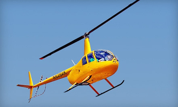 Old City Helicopters, LLC - Davis Islands: $149 for a Bay and Downtown Tampa Helicopter Tour for Up to Three from Old City Helicopters, LLC ($270 Value)