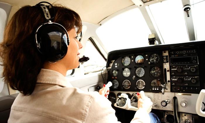 Crosswinds Flight School - Monroe: In-Air Flight Lesson for One at Crosswinds Flight School (60% Off). Four Options Available.