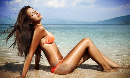 One or Three Airbrush Tans, or One or Three Months of Unlimited Tanning at Ynv Spa and Tanning (Up to 67% Off)