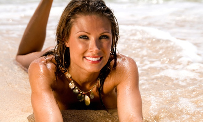 Club Soleil Tanning Company - Multiple Locations: One or Three Spray Tans or One Week of Unlimited UV Tanning at Club Soleil Tanning Company (Up to 83% Off)