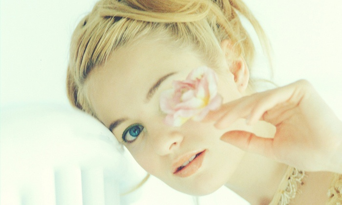 White NY Photography Studio - Midtown South Central: $99 for a One-Hour In-Studio Photo Shoot with Prints at White NY Photography Studio ($420 Value)