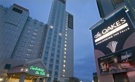 groupon daily deal - 1-Night Stay with Optional Gourmet Dinner and Wine Tours at The Oakes Hotel Overlooking the Falls in Niagara Falls, ON