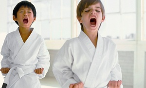 Karate Kids Love: Eight Karate Classes with Uniform or Four Classes at America's Ultimate Universal System of Martial Arts (Up to 88% Off)