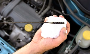 Tolimas Auto Center: Three Oil Changes or One Oil Change with Tire Rotation and Inspection at Tolimas Auto Center (Up to 61% Off)
