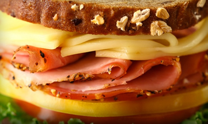 The Gourmet Deli - Multiple Locations: Sandwich Meal for 2 with Soup or Salad, or Catering Package for 10 at The Gourmet Deli (Up to 48% Off)