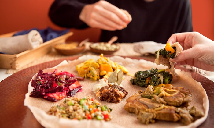 Blue Nile Ethiopian Cuisine - Central City: $11 for $20 Worth of Ethiopian Food and Nonalcoholic Drinks at Blue Nile Ethiopian Cuisine