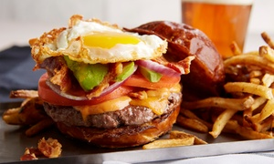 Stacked Gourmet Burger Bar: Gourmet Burgers, Sides, and Drinks for Two or Four at Stacked Gourmet Burger Bar (47% Off)