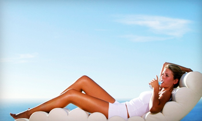 Hawaiian Glo - St. Charles Community College: One or Three Norvell Spray Tans or One Month of Unlimited UV Tanning at Hawaiian Glo in St. Peters (Up to 54% Off)