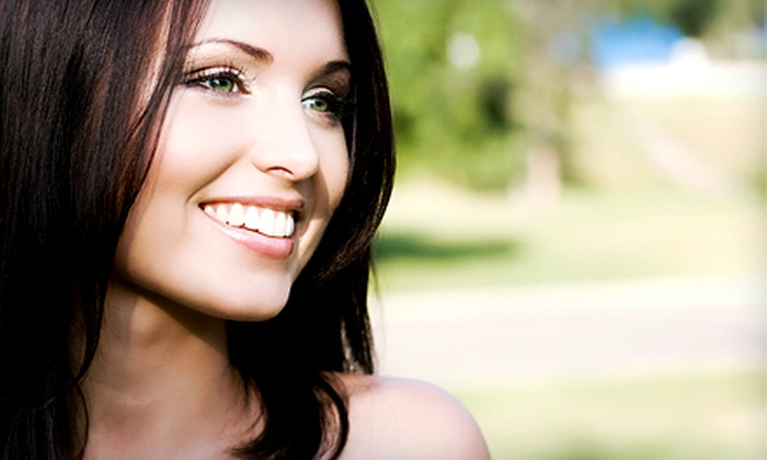 Dr. Swamy and Associates - Clinton Township: Dental-Exam Package or Crown for One, or Teeth Whitening for One or Two at Dr. Swamy and Associates (Up to 75% Off)