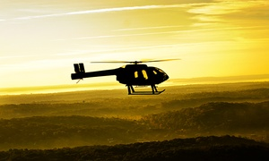 Wings Air Helicopters: Piloting Experience for 1 with a Guest or New York City Helicopter Tour for 2 from Wings Air Helicopters (Up to 48% Off)