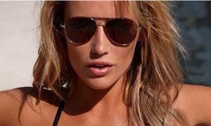 Studio K Tanning: Up to 66% Off Air Brush or Spray Tans  at Studio K Tanning