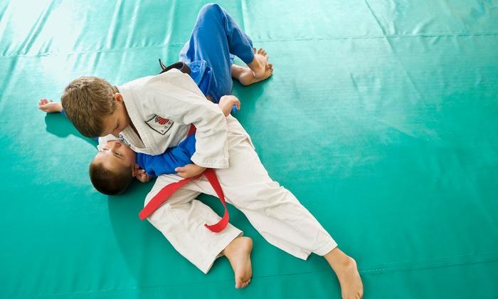 PTC Combat Fitness - Peachtree City: One Month of Unlimited Kickboxing or Kids' Brazilian Jiu Jitsu Classes at PTC Combat Fitness (Up to 65% Off)