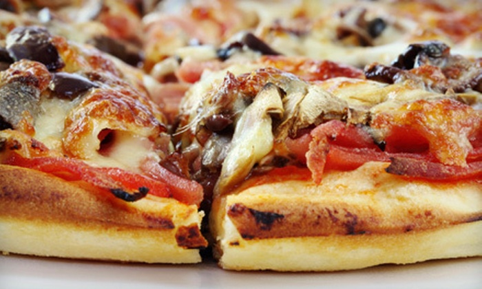 No Ordinary Pizza - Northmoor Estates: $12 for a Pizza Meal with Cheese Garlic Bread and 2-Liter Soda at No Ordinary Pizza in Broomfield (Up to $23.67 Value)