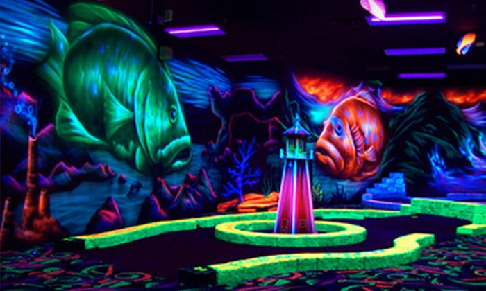 Oceans 18 - New Bedford: Black-Light Mini-Golf and Mini-Bowling for Four or Golf Simulator Play at Oceans 18 in New Bedford (Up to 52% Off)