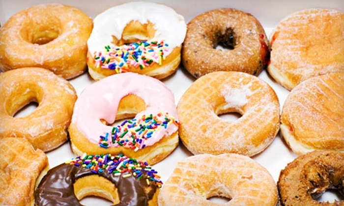 Donut D-Light - Second Ward: $6 for One Dozen Donuts and Two Cups of Coffee at Donut D-Light ($12 Value)