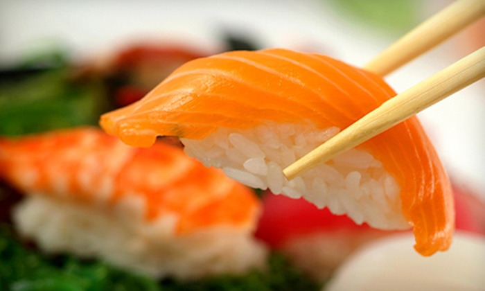 Wasabi Fusion Restaurant - Downtown East: Sushi Dinner with Wine for Two or Four at Wasabi Fusion Restaurant (49% Off)