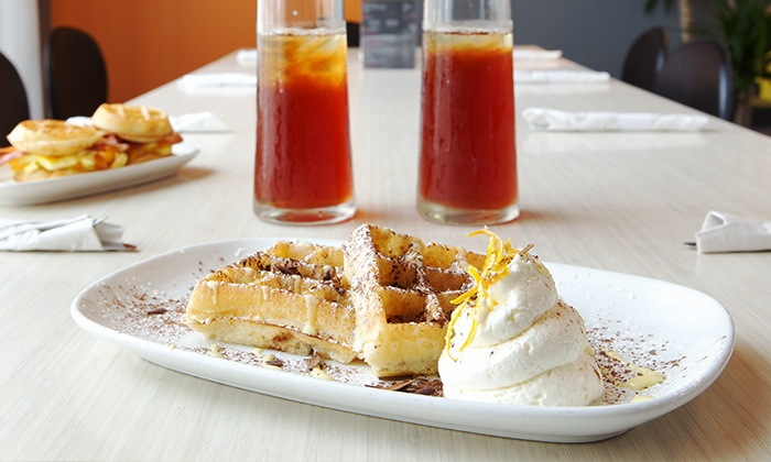 Waffles Cafe and On the Bun - Waffles Ohio Street: Meal for Two or Four, or $11 for $20 Worth of Carryout or Delivery at Waffles Cafe and On the Bun