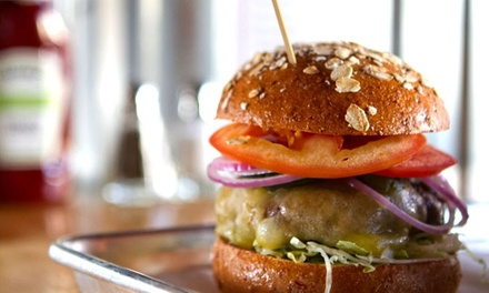 Organic Burgers, Sides, and Drinks for Two or Four at Burger Village (Up to 55% Off)