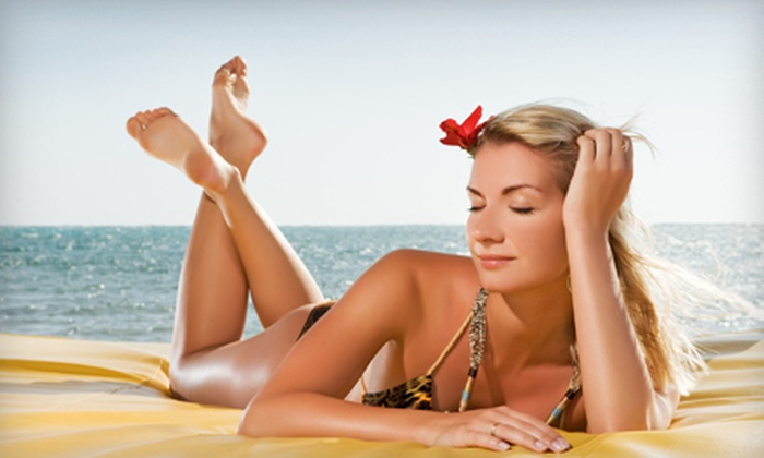 Guiltless Glow - Highland: $24 for Two Norvell  Auto Booth Spray Tans at Guiltless Glow ($58 Value)