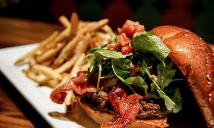 Buzz Burgers, Barrels, and Beers - North Center: Two or Four Gourmet Burgers and Sides for Dinner at Buzz Burgers, Barrels, and Beers (47% Off)
