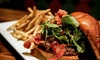 BUZZ- burgers , barrels & beer - North Side: Two or Four Gourmet Burgers and Sides for Dinner at Buzz Burgers, Barrels, and Beers (47% Off)