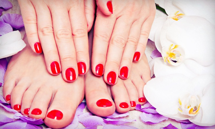 Zoë Salon & Spa - Multiple Locations: Cranberry Spa Manicure and Pedicure or Full Set of Acrylic Nails at Zoë Salon & Spa (Up to 51% Off)