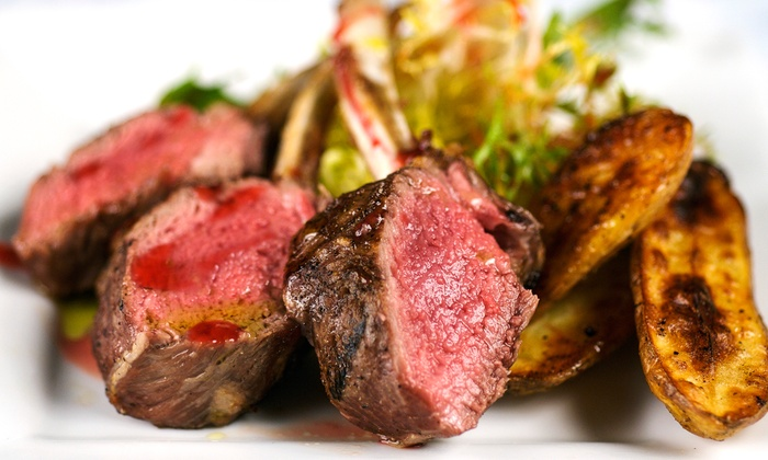 The Grey Moss Inn Restaurant - Northwest Side: $44 for $80 Worth of Steaks and Seafood at The Grey Moss Inn Restaurant. Groupon Reservation Required.