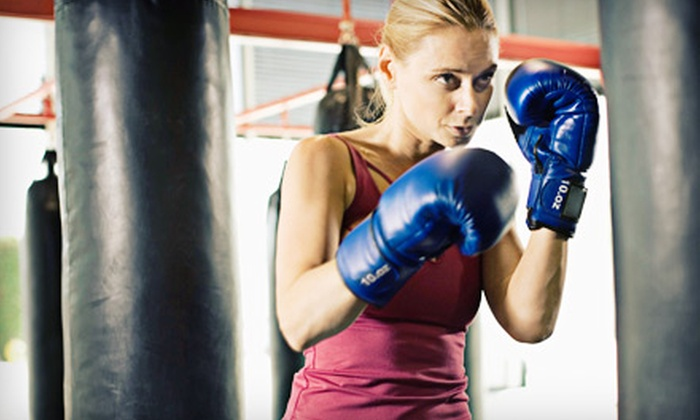 TITLE Boxing Club - The Woodlands: $22 for Two Weeks of Unlimited Boxing and Kickboxing Classes with Wraps at TITLE Boxing Club ($44.49 Value)