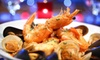 Nomad - East Village: Three Course North African Dinner for Two or Four with Dessert, Wine, and Comedy Show Tickets at Nomad (Up to 51% Off)