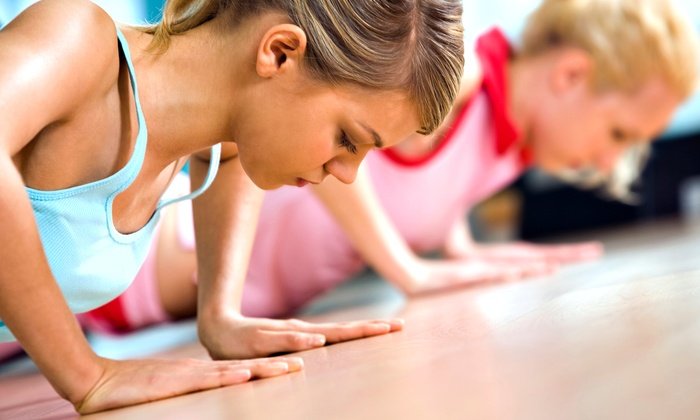 Kosama - Kosama - Coralville: $49 for One Month of Unlimited Fitness Classes at Kosama ($199 Value)