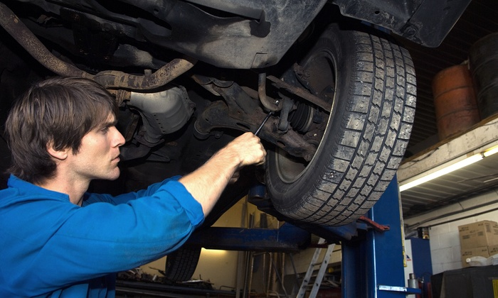 Carlsons Auto Centre - North Industrial: Wheel Alignment or Winter Inspection with Oil Change and Tire Rotation at Carlsons Auto Centre (Up to 65% Off)
