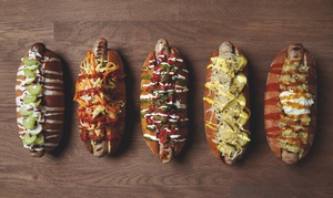 Hungerdog: Choice of One or Two Gourmet Hotdogs with One or Two Sides at Hungerdog (Up to 51% off)