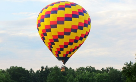 $299 for a Sunrise Semi-Private Hot Air Balloon Ride for Two with Champagne from A&A Balloon Rides, LLC ($450 Value)