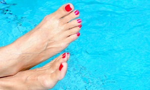 T.H.E. Salon: One or Two Mani-Pedis, or a Gel Mani-Pedi at  T.H.E. Salon (Up to 46% Off)