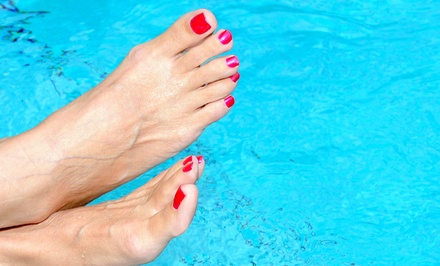 One or Two Mani-Pedis, or a Gel Mani-Pedi at  T.H.E. Salon (Up to 54% Off)