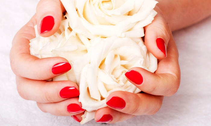 Salon at Tiffany's - St. Petersburg: Basic or Deluxe Manicure and Pedicure at Salon at Tiffany's (Up to 56% Off)