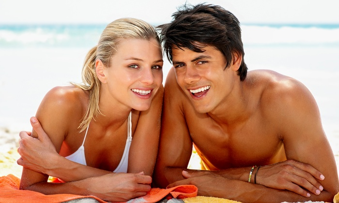 Tan Me Inc - University Park: One Month of VersaSpa or VersaPro Spray Tans or UV Tans at Tan Me Inc (Up to 70% Off)